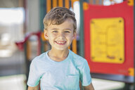 Portrait of happy boy on playground in kindergarten - ZEF15470