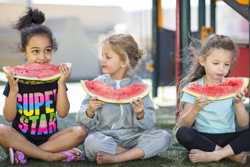 Three girls eating watermelons in kindergarten - ZEF15473