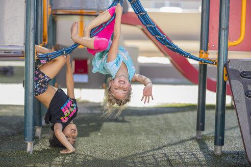 Happy girls playing on playground of a kindergarten - ZEF15479
