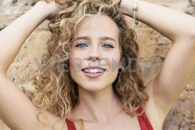 Portrait of smiling blonde woman - IGGF00496