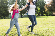 Happy mother with daughter in a park - UUF13768