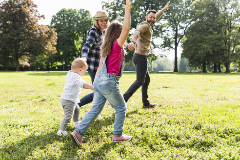 Active happy family in a park - UUF13771