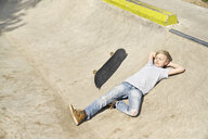 Boy relaxing in skatepark - PDF01648