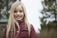 Portrait of girl with long blond hair outdoors - CUF09591