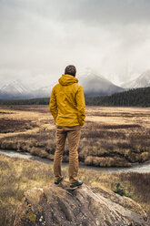 Man standing, looking at view, rear view, Kananaskis Country, Bow Valley Provincial Park, Kananaskis, Alberta, Canada - CUF09612