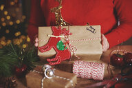 Cropped view of woman holding christmas present - CUF09639
