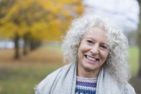 Portrait smiling senior woman in autumn park - CAIF20519