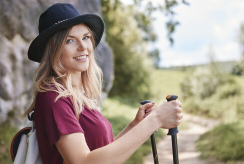 Portrait of woman with walking poles looking at camera smiling, Krakow, Malopolskie, Poland, Europe - CUF10497