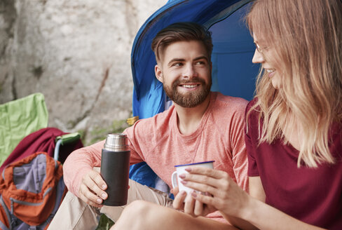 Couple camping, sitting by tent, Krakow, Malopolskie, Poland, Europe - CUF10506