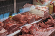 Butchery, various meats in refrigerated counter - AFVF00461