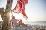 Woman sitting on beach relaxing, Palma de Mallorca, Islas Baleares, Spain, Europe - CUF10738