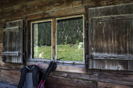 Germany, Bavaria, Berchtesgaden Alps, Wasseralm, wooden hut, backpack and hiking poles - HAMF00303