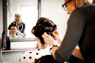 Woman working in quirky hair salon - CUF10974