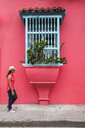 Woman exploring the streets of Cartagena, Bolivar, Colombia, South America - CUF11196
