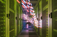 Interior of data centre, lights trails showing travelling data - CUF11232