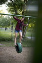 Young woman having fun on a swing - BEF00090
