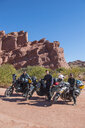 Group of friends standing beside touring motorbikes in desert, Salta, Argentina, South America - CUF11814