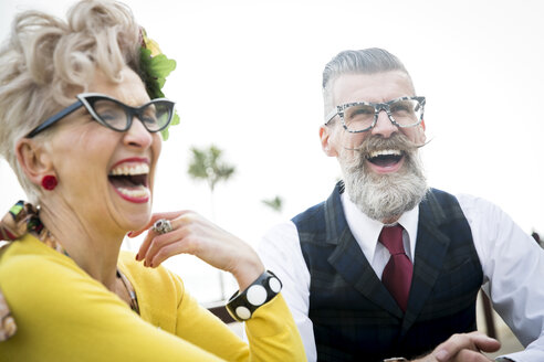 1950's vintage style couple laughing together at coast - CUF12173