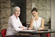 Portrait of two businesswomen at office desk - CUF12308
