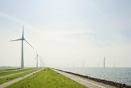 On and off shore wind turbines at IJsselmeer lake, Netherlands - CUF12716