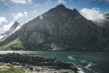 Norway, Lofoten, Moskenesoy, Young men camping at Horseid Beach - GUSF00859