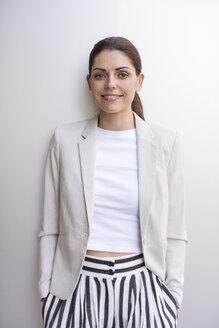Portrait of smiling businesswoman - DIGF04326