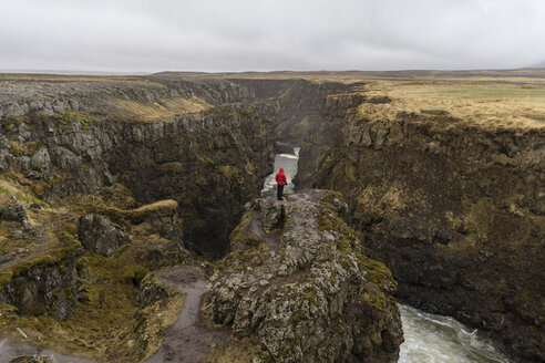 Iceland, North of Iceland, hiker looking to canyon - AFVF00526