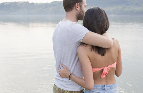 Couple hugging by river - ISF02268