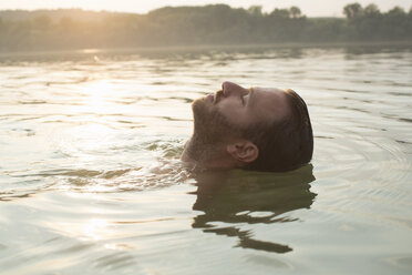 Man relaxing, floating in river - ISF02280