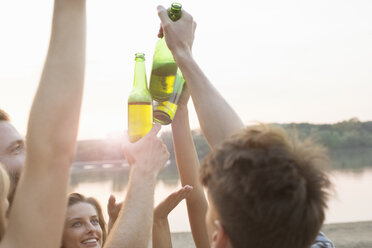 Group of friends drinking, enjoying beach party - ISF02289