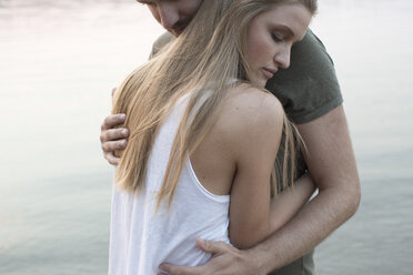 Couple hugging by river - ISF02292