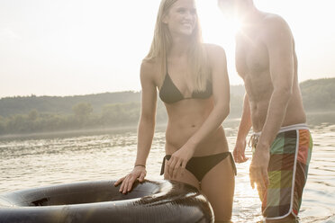 Couple with inflatable ring in river - ISF02298