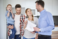 Family and real estate agent talking in new apartment - ABIF00456