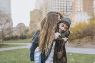Young couple hugging in park, Boston, Massachusetts, USA - ISF02453