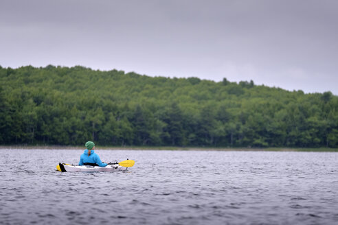 Kayaker kayaking, Kejimkujik Lake, Nova Scotia, Canada - ISF02510