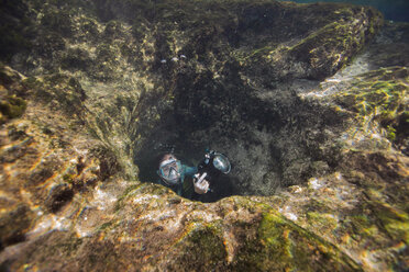 Man in underwater cave with camera - ISF02525