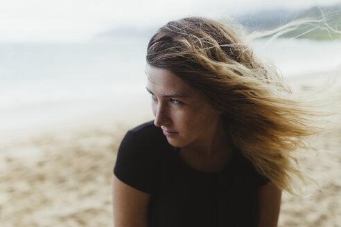 Portrait of woman on beach looking away, Oahu, Hawaii, USA - ISF02998