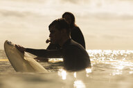 Two friends in sea with surfboards - ISF03010