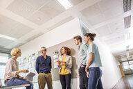 Digital design team talking in office meeting - ISF03394