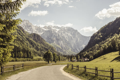 Landscape view of rural road in valley and mountains, Mozirje, Brezovica, Slovenia - ISF03535