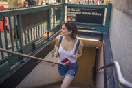 Woman coming out of subway, Manhattan, New York, US - ISF03730