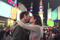 Couple kissing in Times Square, New York, United States, North America - ISF03742