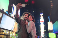 Couple taking selfie in Times Square, New York, United States, North America - ISF03745