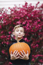 Portrait of boy holding pumpkin - ISF03802