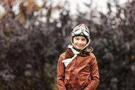 Portrait of girl wearing pilot costume for halloween in park - ISF03814