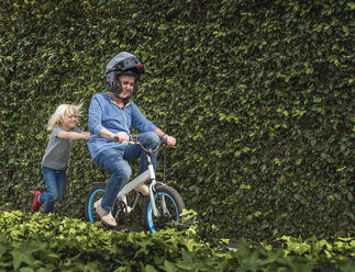 Grandson pushing grandmother on his bicycle - ISF04213
