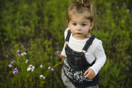 Portrait of girl playing in field - ISF04390