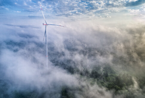 Germany, Baden-Wuerttemberg, Schurwald, Aerial view of wind wheel and morning fog - STSF01561