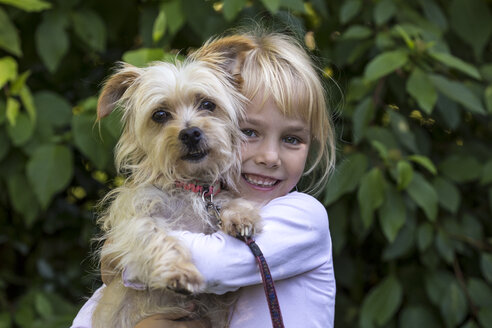 Portrait of happy little girl with her dog - JFEF00865