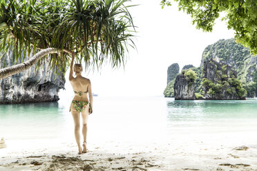 Thailand, Ko Hong, back view of woman standing on the beach looking to the sea - CHPF00467